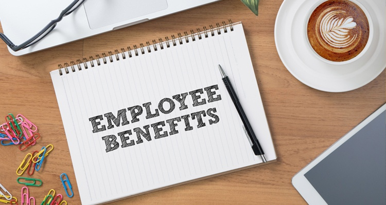 Employee benefits on paper with workplace stationery