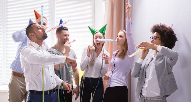 Employees celebrating with a fun employee culture.