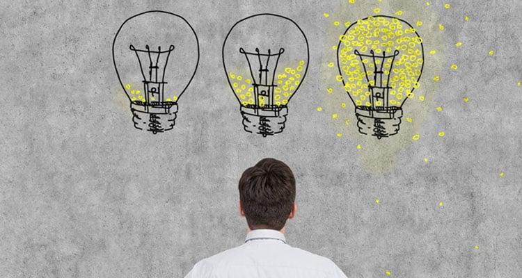 Employee with three idea bubbles