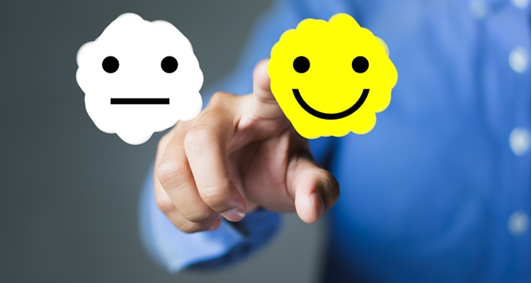 Happy employee pushing a happy face button