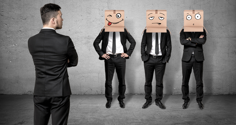 Corporate man looking at three versions of employees - happy, sad and surprised.