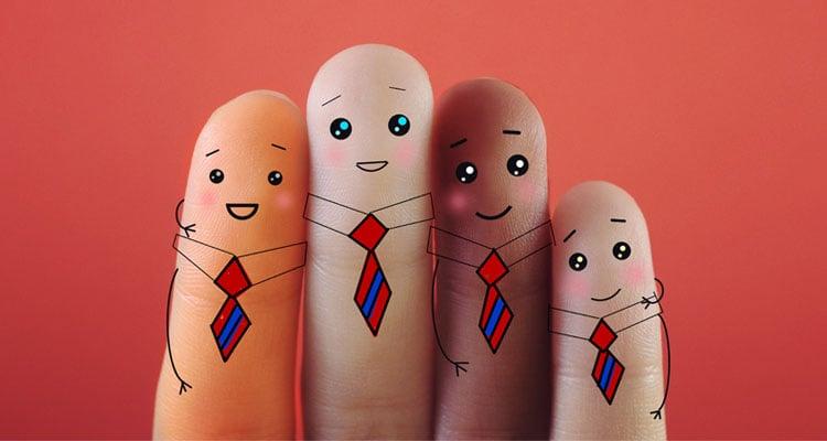 Fingers dressed up as employees wearing ties