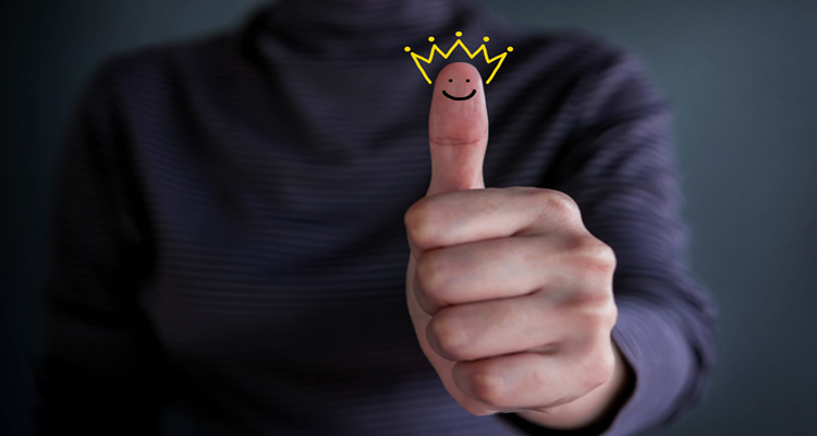 Thumbs up with a happy face and crown.
